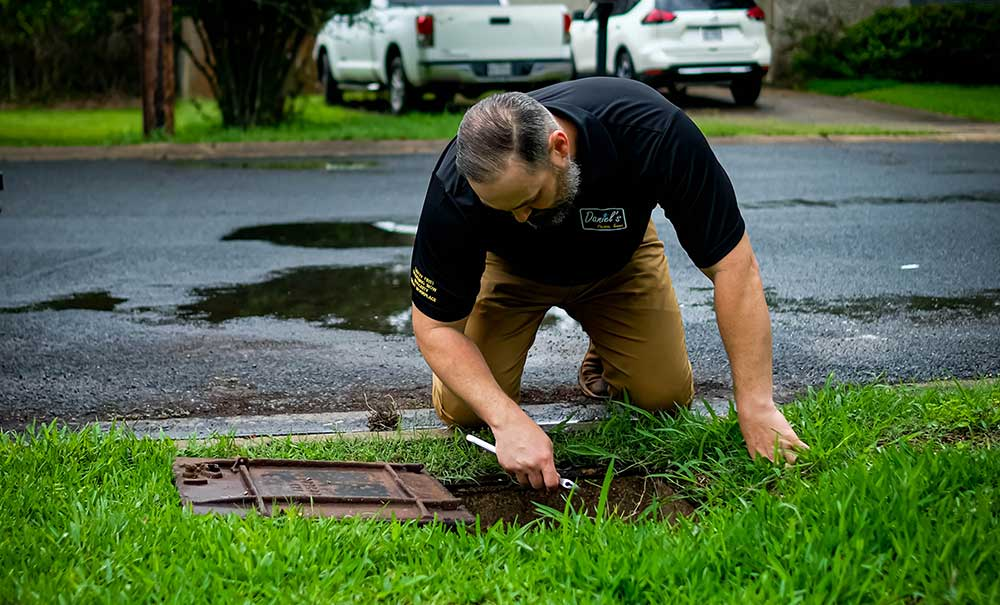 plumber performing sewer services austin tx