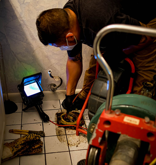 plumber performing sewer camera inspection austin tx